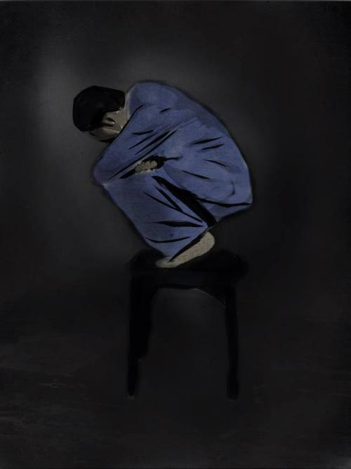 person in fetal position, standing on a chair